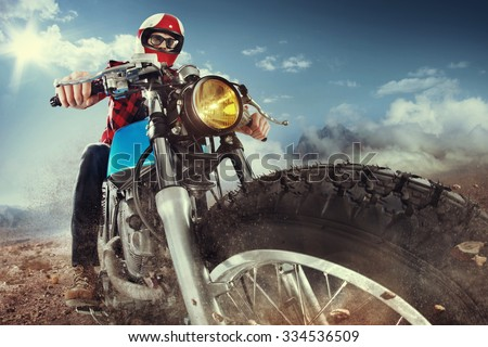 Biker seat on the motorcycle under sky with clouds