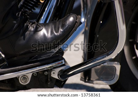 Bikers Boot on Motorcycle Footrest