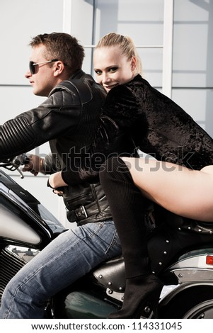 Bikers couple riding on motorcycle