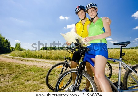 bikers holding a map