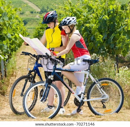 bikers holding a map in vineyard, Czech Republic