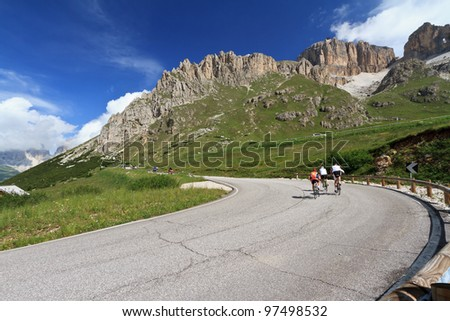 bikers on the road from Canazei to Pordoi pass, Trentino, Italy