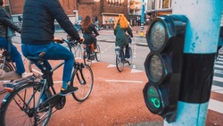 Bikes and bikers are riding in Amsterdam