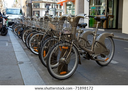 Bikes for rent in the street in Paris, France. - stock photo