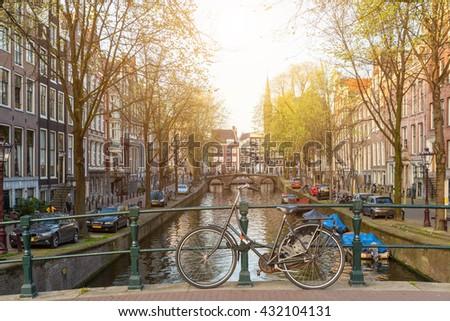 Bikes on the bridge in Amsterdam ,Netherlands. Amsterdam transportation in Netherlands. Amsterdam is capital city of Netherlands.