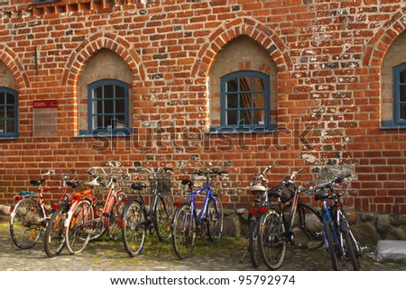 Bikes parked against a wall in the old town in Ystad in Sweden in Europe