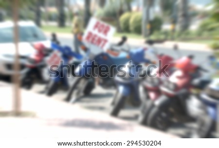 bikes scooter on a renting house-blurred