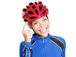 Biking helmet woman pointing at bicycle helmet ? remember to wear your bike helmet! Beautiful young chinese asian / caucasian woman isolated on white background.