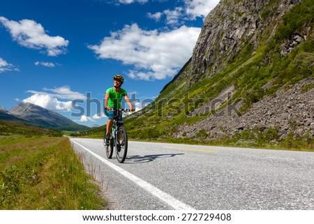 Biking in Norway against picturesque landscape #272729408