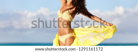 Bikini body swimsuit woman with yellow fashion sarong showing weight loss fat belly reduction. Spa beauty salon for skin care healthy girl. Panorama banner. Panoramic header background crop.