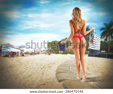 Bikini girl walking with bag and thong #286470146