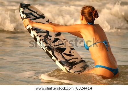 Bikini Girl with boogie board in the water