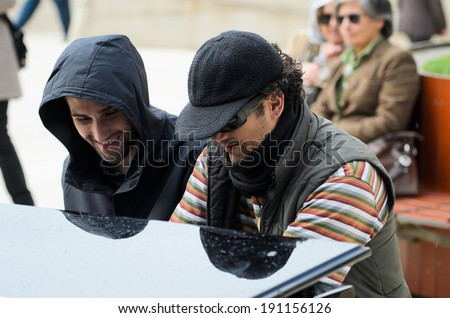 BILBAO, SPAIN - APRIL 4, 2014: Two men in  plays a grand piano during music initiative \