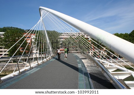 BILBAO, SPAIN -MAY 30: Bridge architect Santiago Calatrava in Bilbao, on May 30, 2012. The floor is covered with carpet, because the glass slide due to the humid climate of the city #103992011