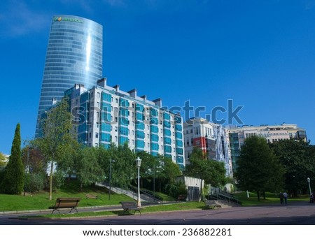 BILBAO, SPAIN, OCTOBER 27, 2014: View of the central park in spanish building with iberdrola skyscraper behind it.