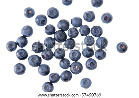 Bilberries on the wite surface