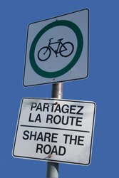 bilingual share the road sign in french and english