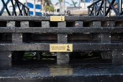 Bilingual Sign on Steps Painted Black in English and Spanish - Pise Con Cuidado  Watch Your Step