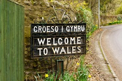 Bilingual Welcome to Wales sign in Welsh and English marking the border between England and Wales on the old coaching route at the town of Chirk UK