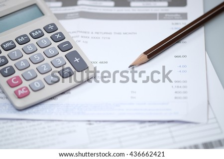 Bill and calculator with pencil, Bill of finance, Bill of electricity, Bill for medical, Macro paper bill, Bill for income and expenditure, Pencil with calculator on finance bill selective focus