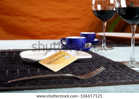 bill and credit card on white plate at restaurant