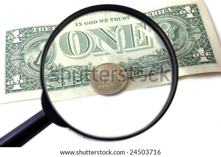 Bill 1 dollar and coin 1 ruble under magnifying glass