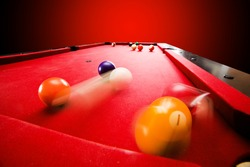 Billards pool game. Breaking the color ball from triangle. Red cloth table