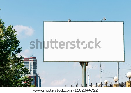 Billboard, billboard, canvas billboard, layout on the background of the city. The concept of outdoor advertising, marketing, sales. mockup