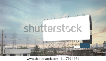 billboard blank on road in city for advertising background.evening time