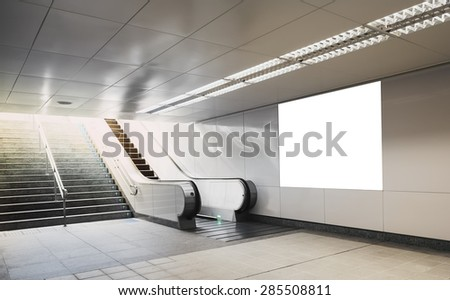 Stock Photo Billboard mock up in subway with escalator