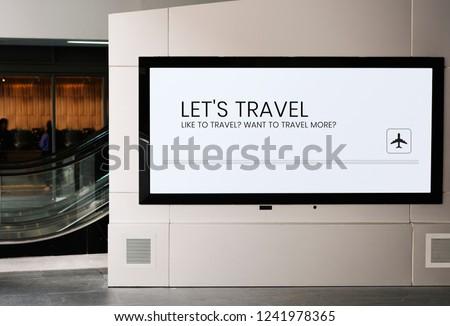 Billboard mockup near an escalator at a train station