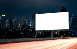 Billboard mockup outdoors, Outdoor advertising poster at night time with street light line for advertisement street city night. With clipping path on screen.