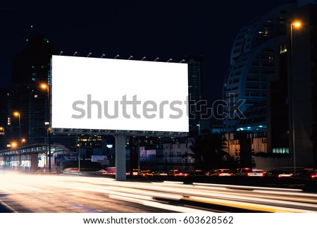 Billboard mockup outdoors, Outdoor advertising poster at night time with street light line for advertisement street city night. With clipping path on screen - Shutterstock ID 603628562