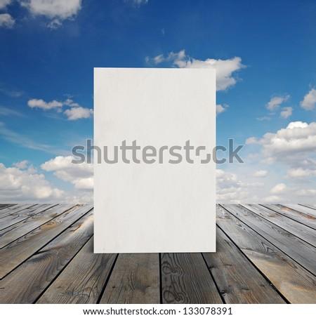 billboard on sunset sky and wood floor, background