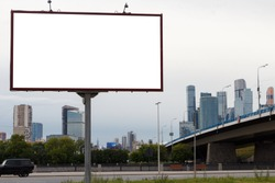 Billboard on the background of the city and the bridge. Mock-up.