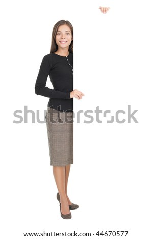 Billboard sign businesswoman. Full length portrait of casual young businesswoman standing with blank white billboard paper sign. Mixed race chinese / caucasian model isolated on white background. - stock photo