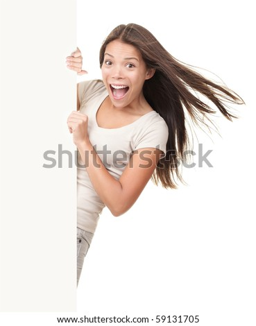Billboard sign. Funny ecstatic young woman screaming joyful while showing copy space on blank white billboard sign. Beautiful Chinese / white Caucasian young woman model.
