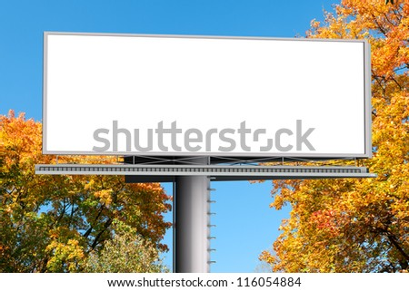 Billboard with empty screen, against red autumn tree