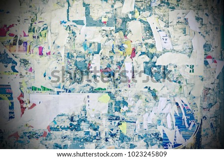 Billboard With Old Torn Ads And Posters Horizontal Grunge Vintage Background. Urban Playbill Colorful Horizontal Texture With Worn Surface For Text Or Image.  Tattered Advertising Panel With Torn Ads