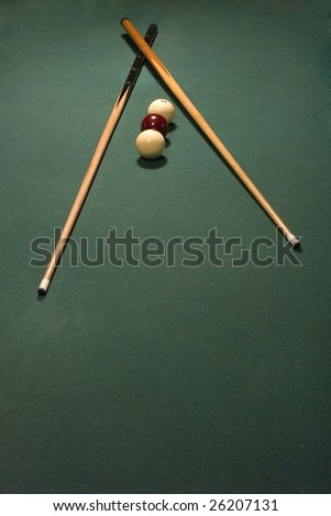 billiard balls and cue on table