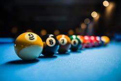 Billiard balls in order in line