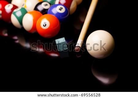 Billiard balls on black background