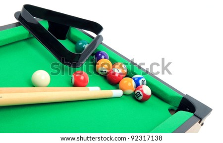 Billiard balls on green table, isolated on white