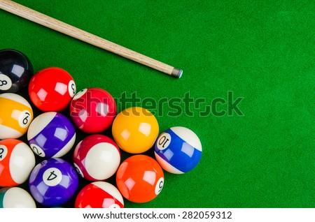 Billiard balls on green table with billiard cue, Snooker, Pool game.