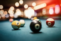 Billiard balls on table. Leisure and gambling concept. Toned image of striped colorful balls