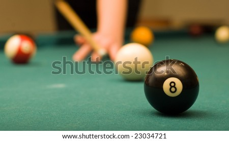 Billiard game (black ball in focus)