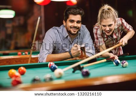 billiard game- smiling couples playing pool game