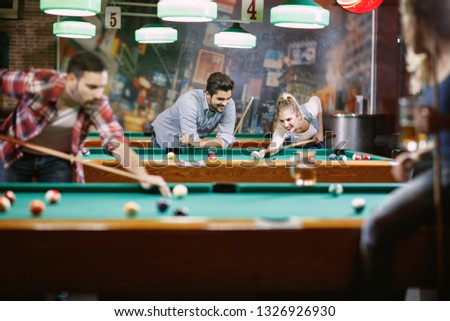 billiard games -Happy people enjoying playing pool together
