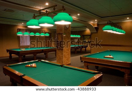 billiard tables in empty room