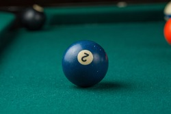 Billiards balls and cue on billiards table. Billiard sport concept